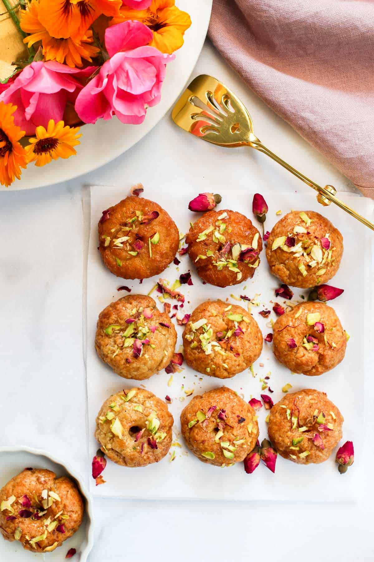 Air Fried Balushahi garnished with pistachios and dried rose petals